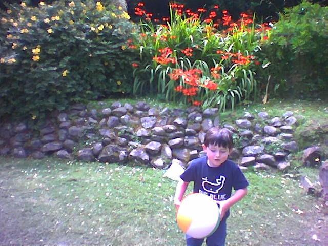 Em_back_garden_playing_ball